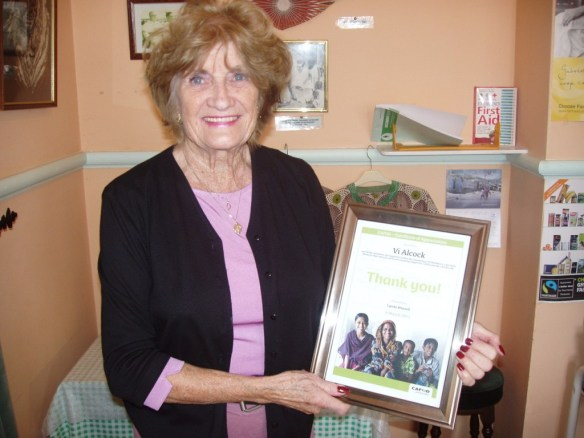 Vi with her special thank you certificate in the CAFOD Cafe
