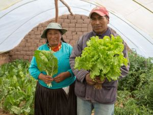 Santos and Joel's father Modesto and his sister, Virginia holding those lovely vegetables