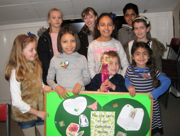 The children showing their green hearts.