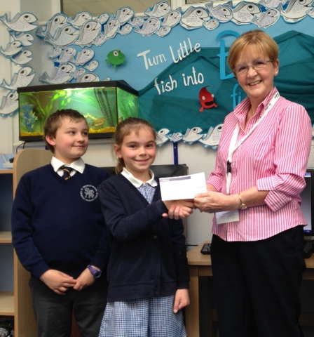 Presenting the cheque to Isobel.