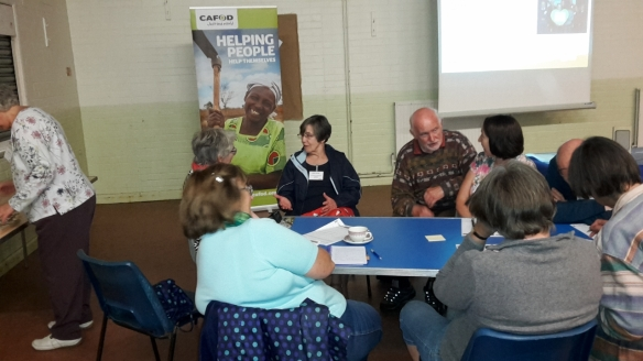 Volunteers discussing Harvest fast day