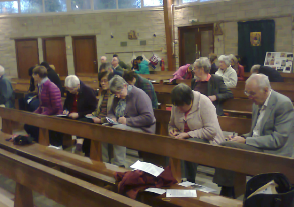 Parishioners signing Power to Be cards