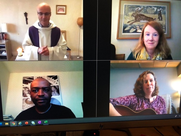 Fr Liam saying our first virtual mass assisted by CAFOD staff