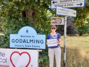 Jo in Godalming with my cancel the debt sign